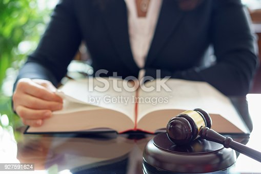 663458084 istock photo Judge gavel and lawyer reading law book. Selective focus 927591624