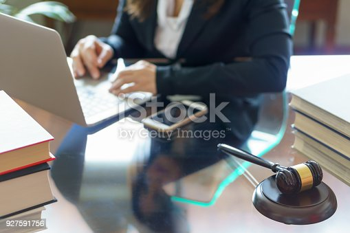 663458084 istock photo Judge gavel and lawyer working on a laptop. Business, legal law, advice and justice concept. Selective focus.Selective focus 927591756