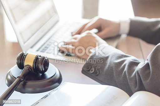 663458084 istock photo Judge gavel and lawyer working on a laptop 994982018