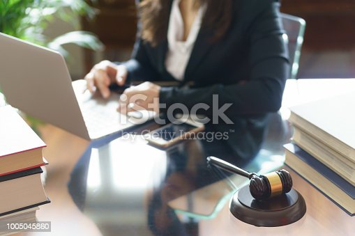 663458084 istock photo Judge gavel and lawyer working on a laptop. Selective focus 1005045860
