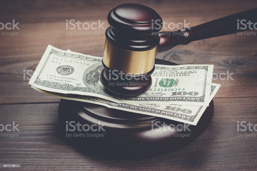 judge gavel and money on brown wooden table stock photo
