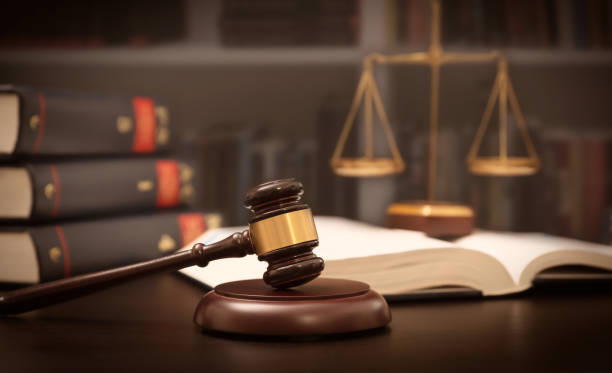 Judge gavel and scale in court. Legal concept stock photo