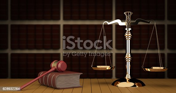istock Judge gavel and scale in library 628932264
