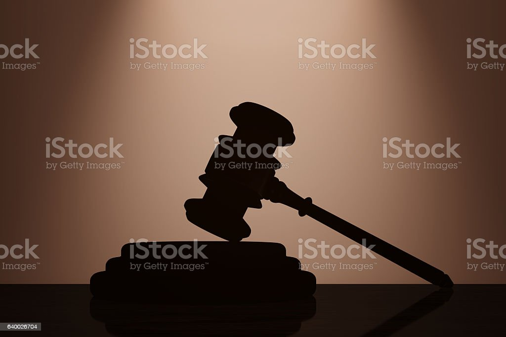 Judge Gavel and Sound Block with backlight over Wall stock photo