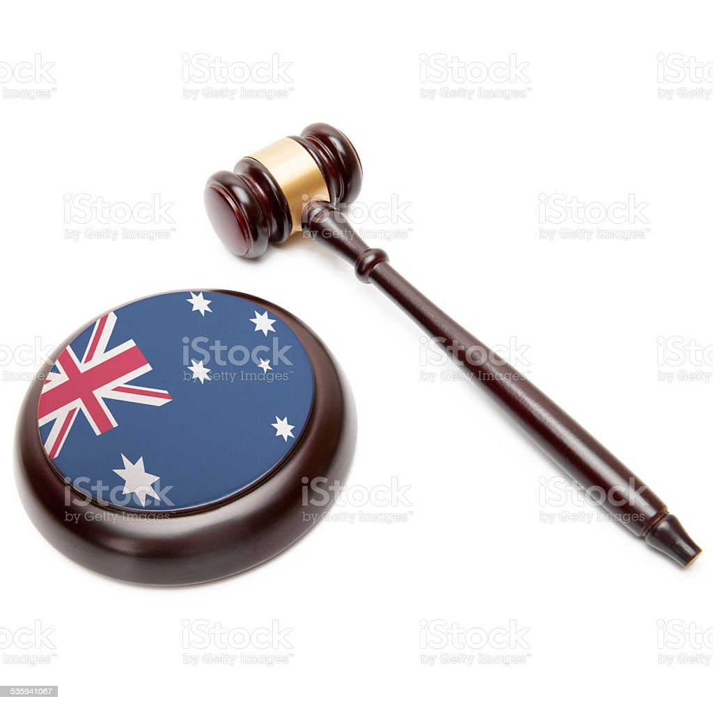 Judge gavel and soundboard with national flag - Australia stock photo