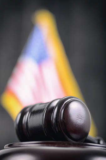 Law and Justice, Legality concept, Judge Gavel and United States of America flag on a black wooden background.