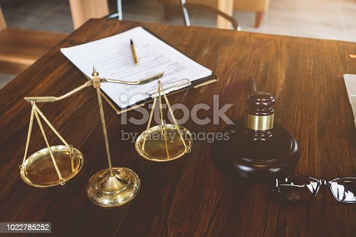 663458084 istock photo Judge gavel ,Golden scales of justice and agreement contract paper, Advice and Legal services Concept. 1022785252