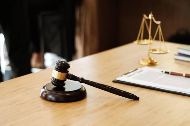 Judge gavel hammer on Lawyer desk. stock photo