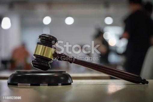 istock Judge Gavel hammer wood on bokeh background 1155523595