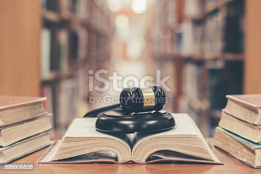 istock Judge gavel on book in library 899906838
