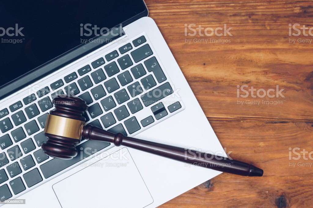 Judge gavel on computer. Concept of internet crime, hacking and cyber crimes стоковое фото