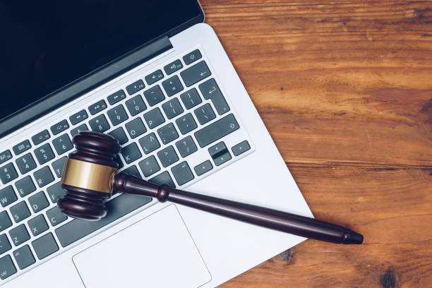 Judge gavel on computer. Concept of internet crime, hacking and cyber crimes stock photo