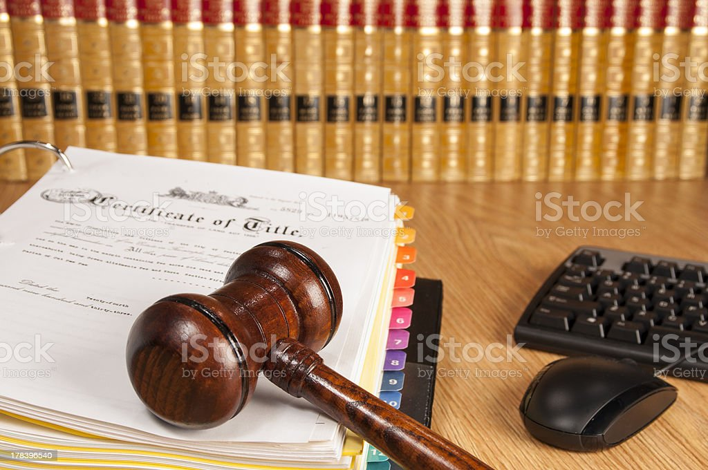 judge gavel on legal document stock photo
