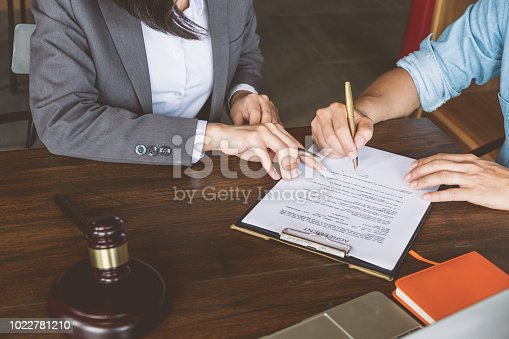 663458084 istock photo Judge gavel with Justice lawyers, Business people and lawyers discussing about agreement papers and contract, Advice and Legal services Concept. 1022781210