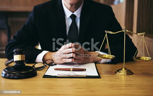 istock Judge gavel with Justice lawyers, Businessman in suit or lawyer working on a documents. Legal law, advice and justice concept 1000686540