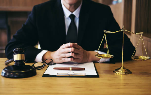 Judge gavel with Justice lawyers, Businessman in suit or lawyer working on a documents. Legal law, advice and justice concept Judge gavel with Justice lawyers, Businessman in suit or lawyer working on a documents. Legal law, advice and justice concept. jurist stock pictures, royalty-free photos & images