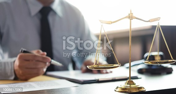 istock Judge gavel with Justice lawyers, Businessman in suit or lawyer working on a documents in courtroom. Legal law, advice and justice concept 1005517030