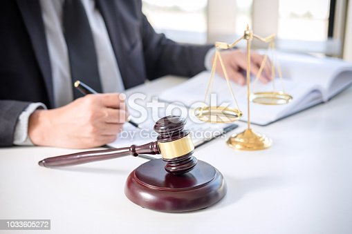 941906652 istock photo Judge gavel with Justice lawyers, Businessman in suit or lawyer working on a documents. Legal law, advice and justice concept 1033605272