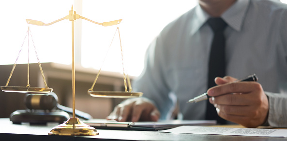 istock Judge gavel with Justice lawyers, Businessman in suit or lawyer working on a documents in courtroom. Legal law, advice and justice concept 1042470920