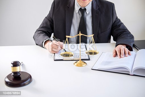 941906652 istock photo Judge gavel with Justice lawyers, Businessman in suit or lawyer working on a documents. Legal law, advice and justice concept 1046676894