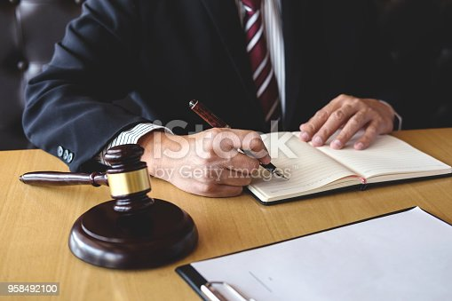 istock Judge gavel with Justice lawyers, Businessman in suit or lawyer working on a documents. Legal law, advice and justice concept 958492100