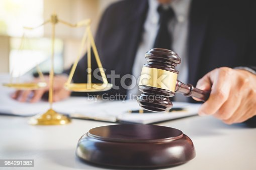 941906652istockphoto Judge gavel with Justice lawyers, Businessman in suit or lawyer working on a documents. Legal law, advice and justice concept 984291382