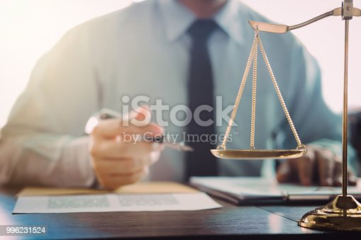 istock Judge gavel with Justice lawyers, Businessman in suit or lawyer working on a documents in courtroom. Legal law, advice and justice concept 996231524