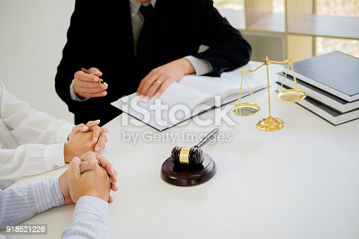 istock Judge gavel with Justice  lawyers having team meeting at law firm in background. Concepts of law. 918521226