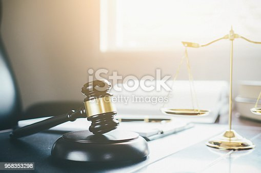 istock Judge gavel with Justice lawyers having team meeting at law firm in background. Concepts of law. 958353298