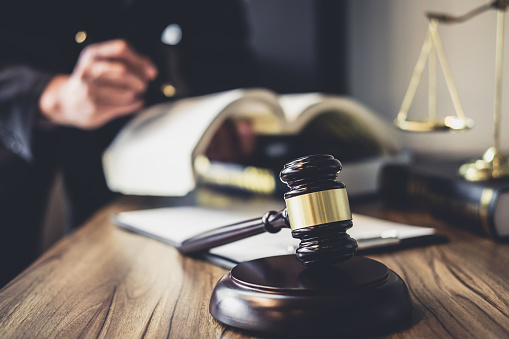 istock Judge gavel with Justice lawyers, Lawyer or Judge counselor working with agreement contract in Courtroom, Justice and Law concept 1057618224