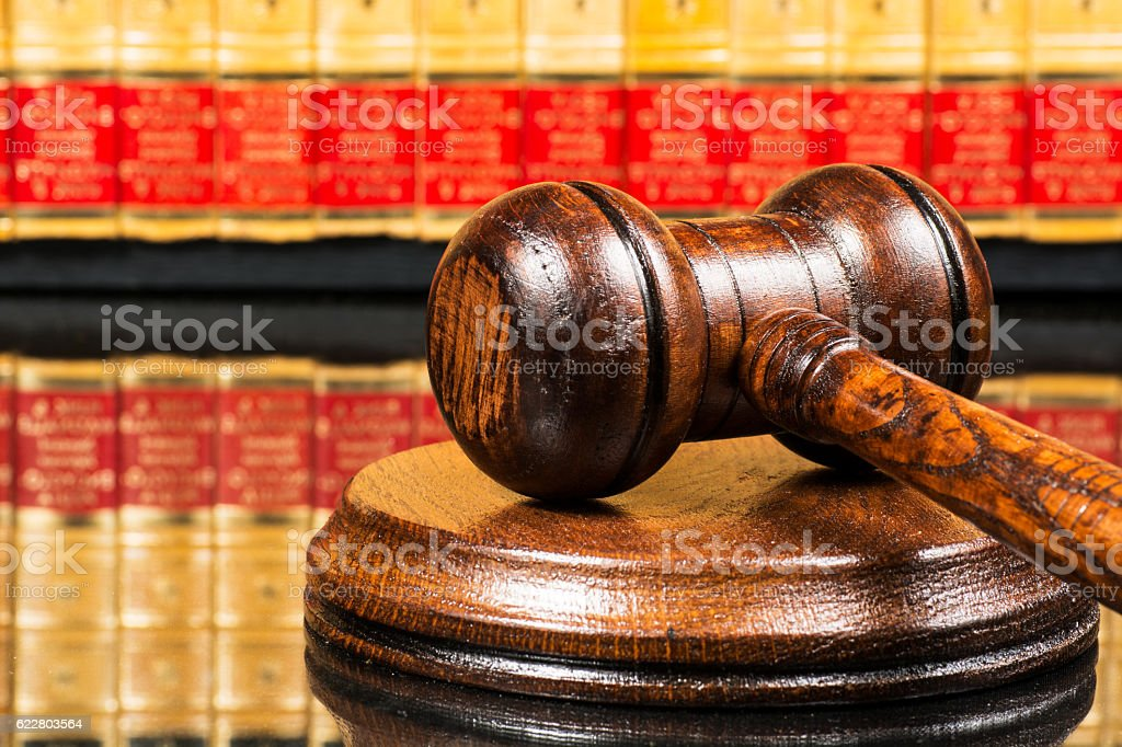 Judge gavel with law books in the background stock photo
