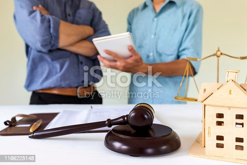 612372074istockphoto Judge gavel with lawyer bakground. Concepts of housing and real estate law. 1166225148