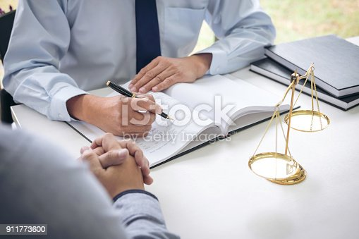 istock Judge gavel with scales of justice, Business people and male lawyers discussing contract papers at law firm in office. Concepts of law 911773600
