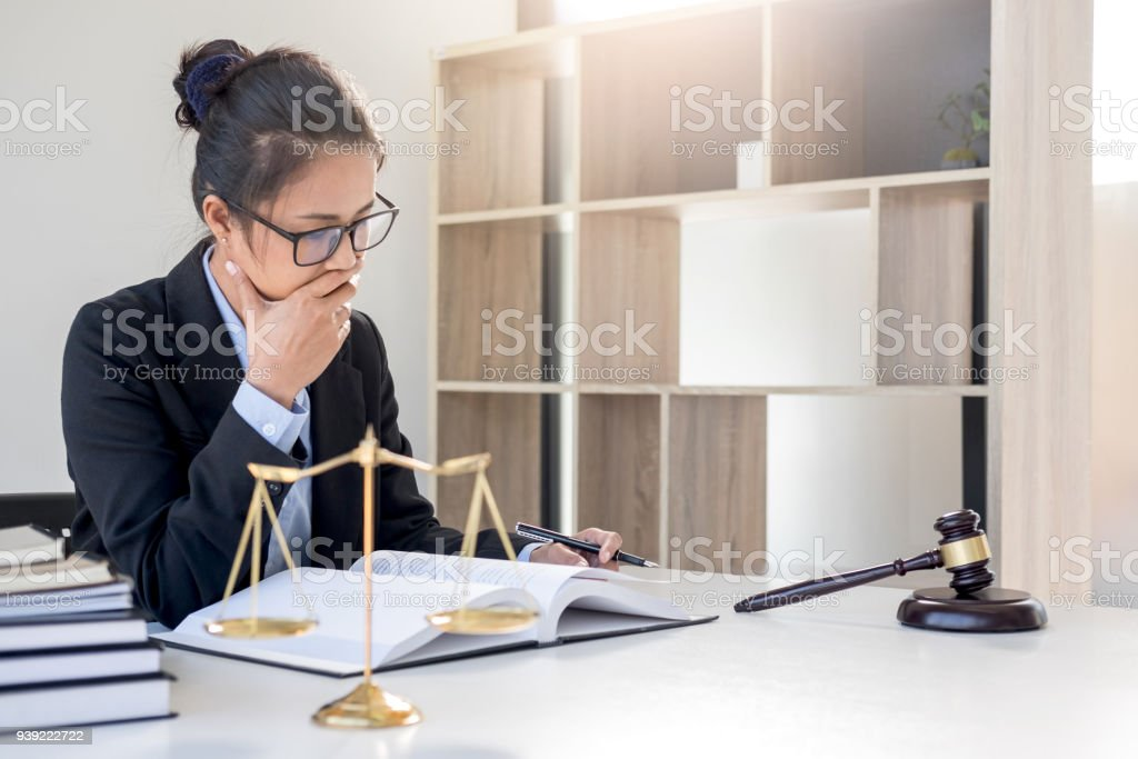 Judge gavel with scales of justice, professional female lawyers working having at law firm in office. Concepts of law stock photo