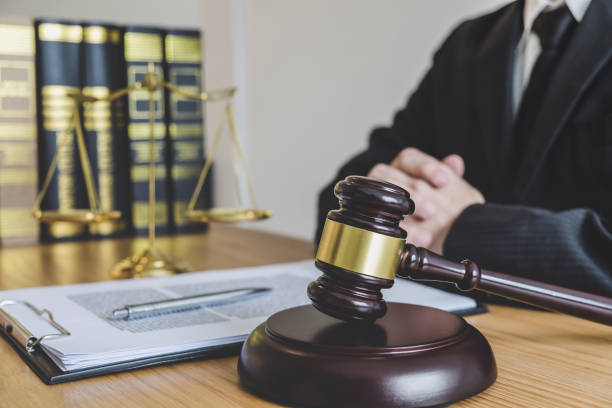 Judge gavel with scales of justice, professional male lawyers or counselor working having at law firm in office. Concepts of law stock photo