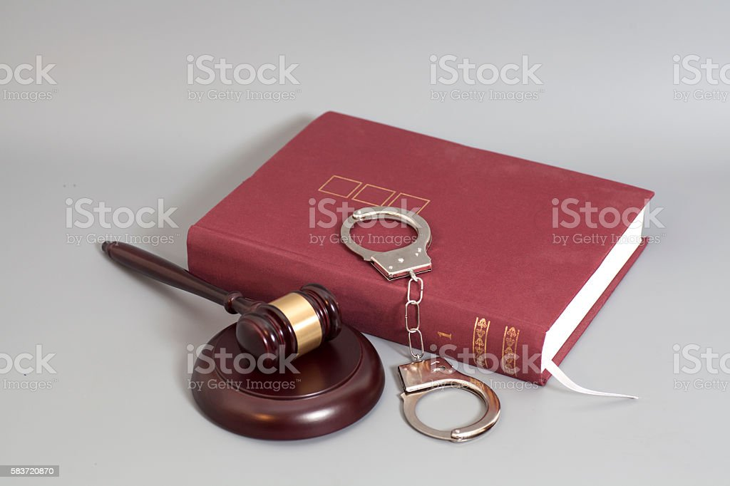 Judge gavel,Handcuffs and book on law stock photo