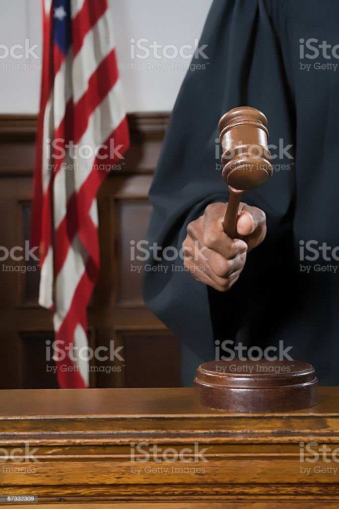 A judge holding a gavel royalty-free stock photo
