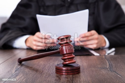 istock Judge Holding Documents 489544923