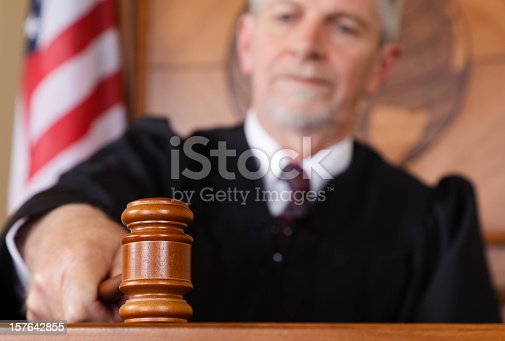 A judge sitting on the bench with focus on the gavel.