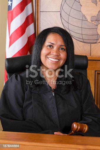 A judge sitting on the bench in the courtroom.