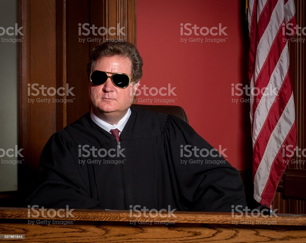 Judge In Elvis Glasses Stock Photo & More Pictures of 55-59