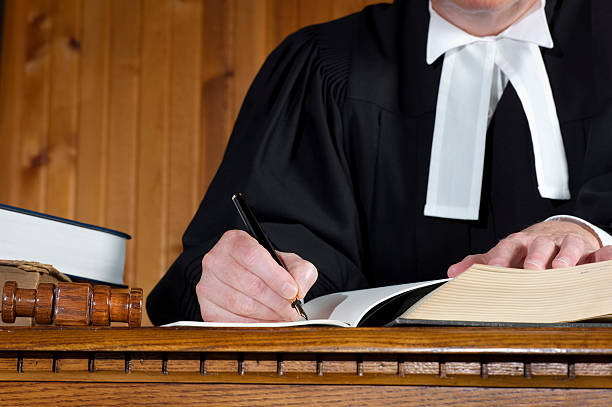 Judge in Traditional Robes Taking Notes stock photo