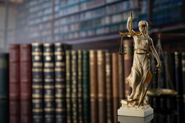 Judge, justice concept background. Symbol of justice – Themis in the old university library. lawyer stock pictures, royalty-free photos & images