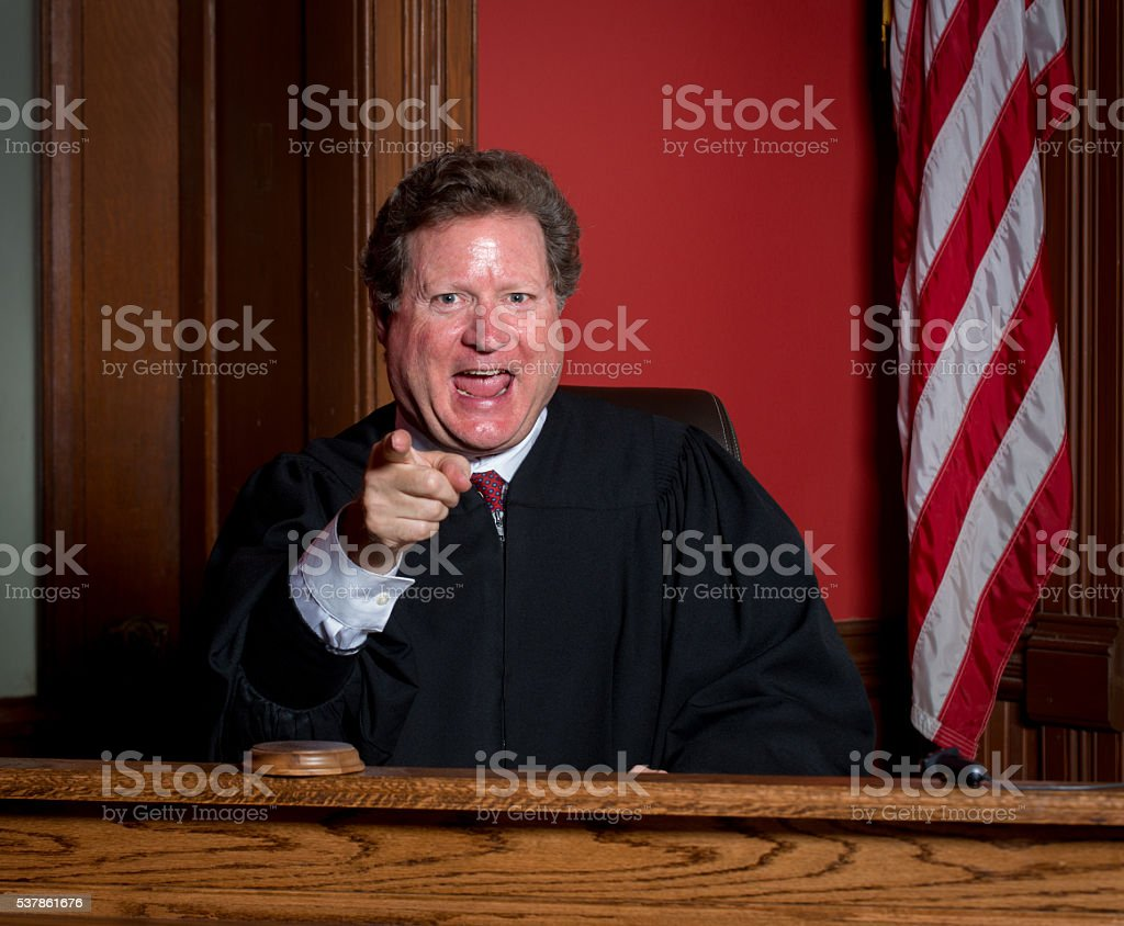 Judge Laughing and Pointing stock photo