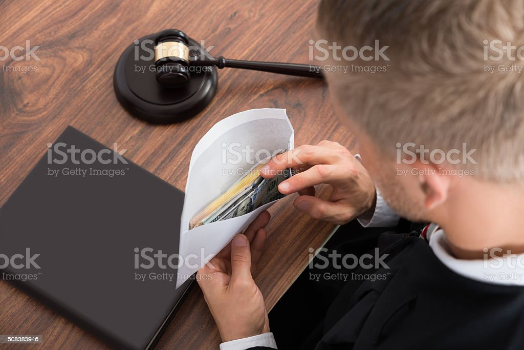 Judge Looking At Money In Courtroom stock photo