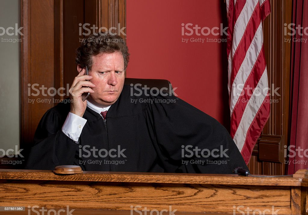 Judge on Cell Phone stock photo