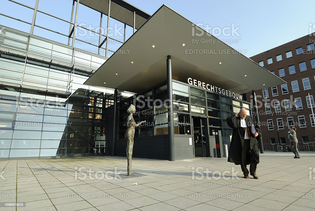 Judge or lawyer leaving courthouse in Utrecht stock photo