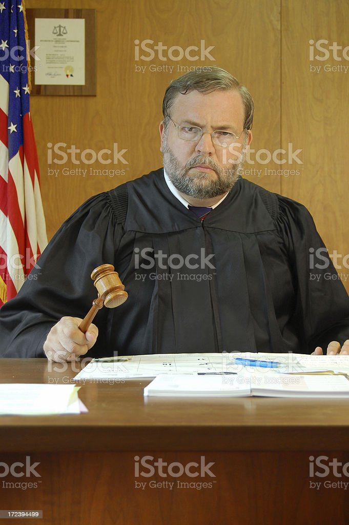 Judge Pounds His Gavel royalty-free stock photo