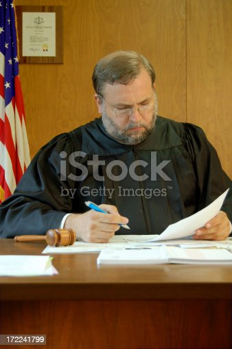 The judge is about to sign some important legal documents.