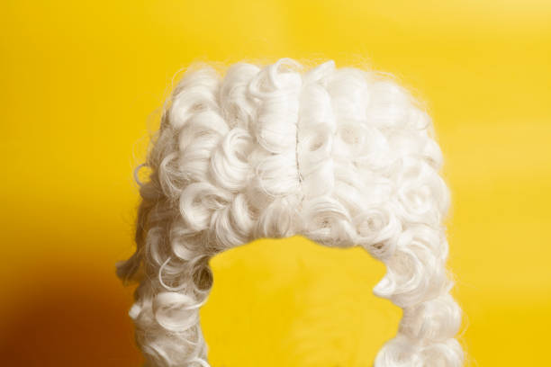 judge wig on yellow background. - judge sports official stock photos and pictures